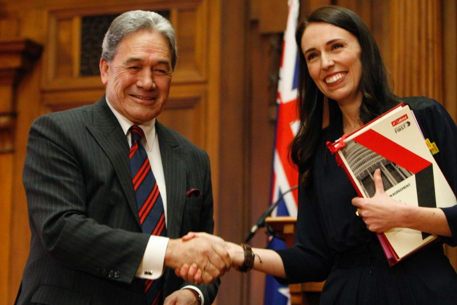 Jacinda Ardern shaking hands with Winston Peters