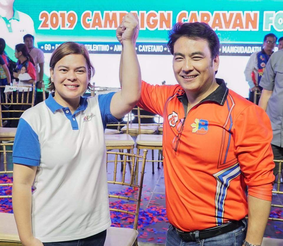 Sara Duterte raising the hand of Bong Revilla