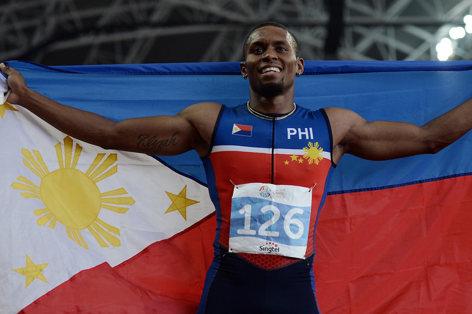 Eric Cray waving the Philippine flag