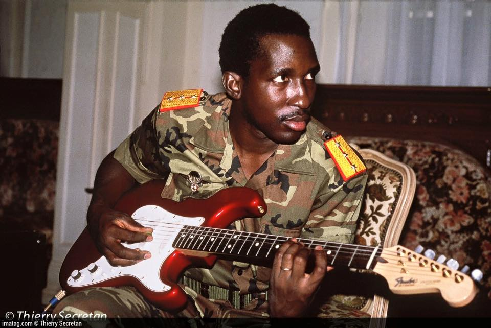 Thomas Sankara playing electric guitar
