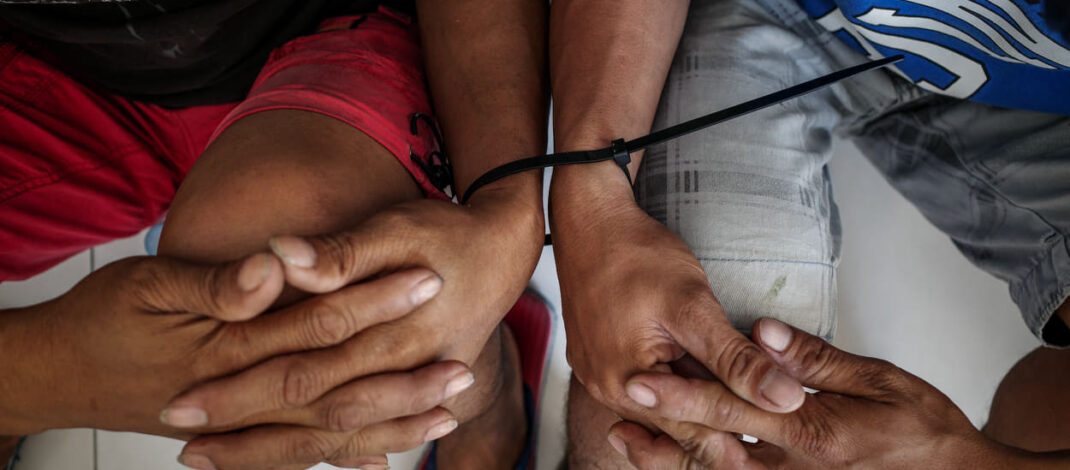 San Roque demonstrators arrested by the Philippine National Police. Photo by Mariel Guerrero for Pinoy Weekly.