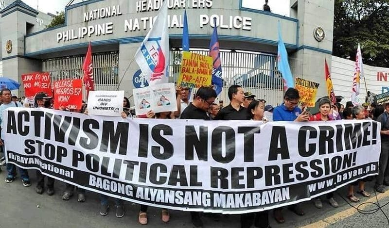 Activist groups stage a protest rally in front of the Philippine National Police headquarters against the Anti-Terrorism Bill. [Photo from Karapatan]