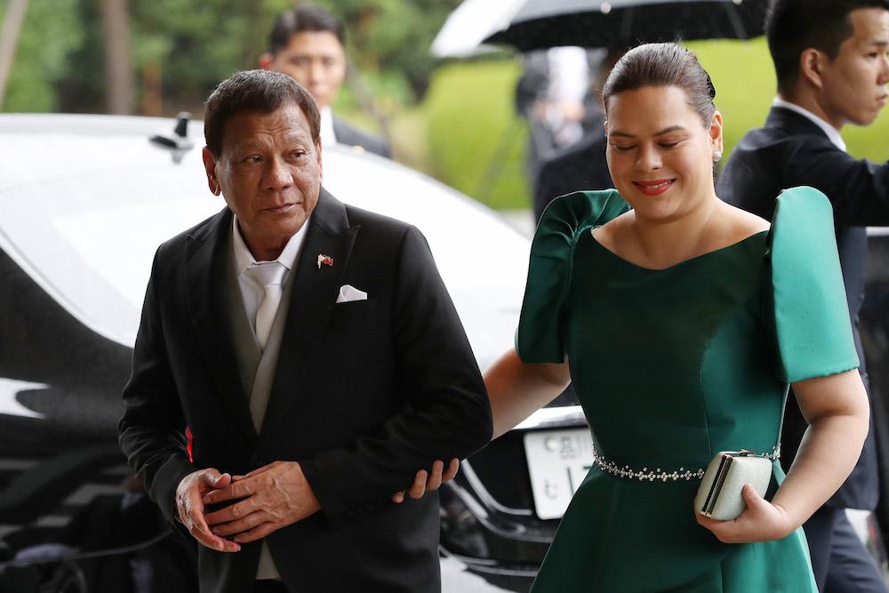 President Rodrigo Duterte walks his daughter and incumbent Davao City mayor Sara Duterte. [Photo: The Asashi Shimbun/Getty Images]